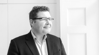 Developer CO—RE has appointed British Land's George Axson to be its associate director.
